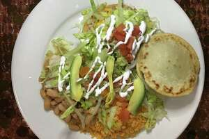 A combo plate with a flauta, chalupa and gordita from Chela's Tacos Mexican Restaurant.