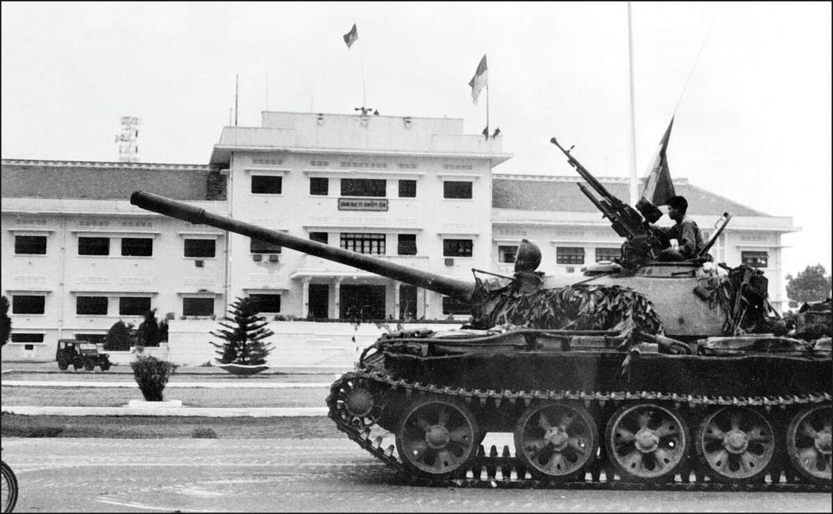 This file photo dated April 30, 1975 shows a soldier perched on a tank of the North Vietnamese Army (NVA) in Saigon, as the city falls into the hands of communist troops.