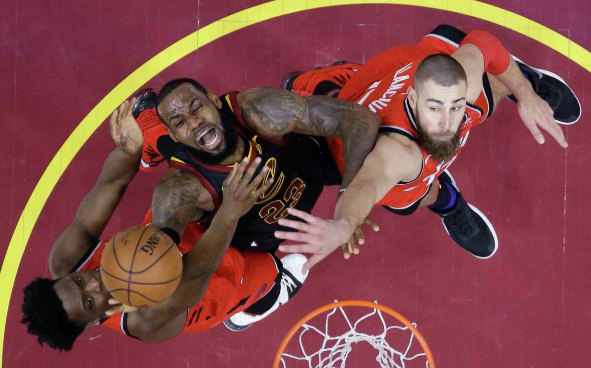 FILE - In this May 5, 2018, file photo, Cleveland Cavaliers' LeBron James (23) goes up for a shot between Toronto Raptors' OG Anunoby, left, and Jonas Valanciunas during the first half of Game 3 of an NBA basketball second-round playoff series in Cleveland. James was named The Associated Press Male Athlete of the Year on Thursday, Dec. 27, 2018.