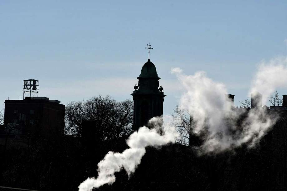 The Albany City School District Administration Building cupola is backlit from Hawk Street Street at Clinton Ave. as steam from the Sheridan Avenue plant rises on a sunny Thursday morning, Dec. 27, 2018, in Albany, N.Y. The former home of Albany Academy was designed by noted Albany architect, Philip Hooker. (Will Waldron/Times Union) Photo: Will Waldron, Albany Times Union