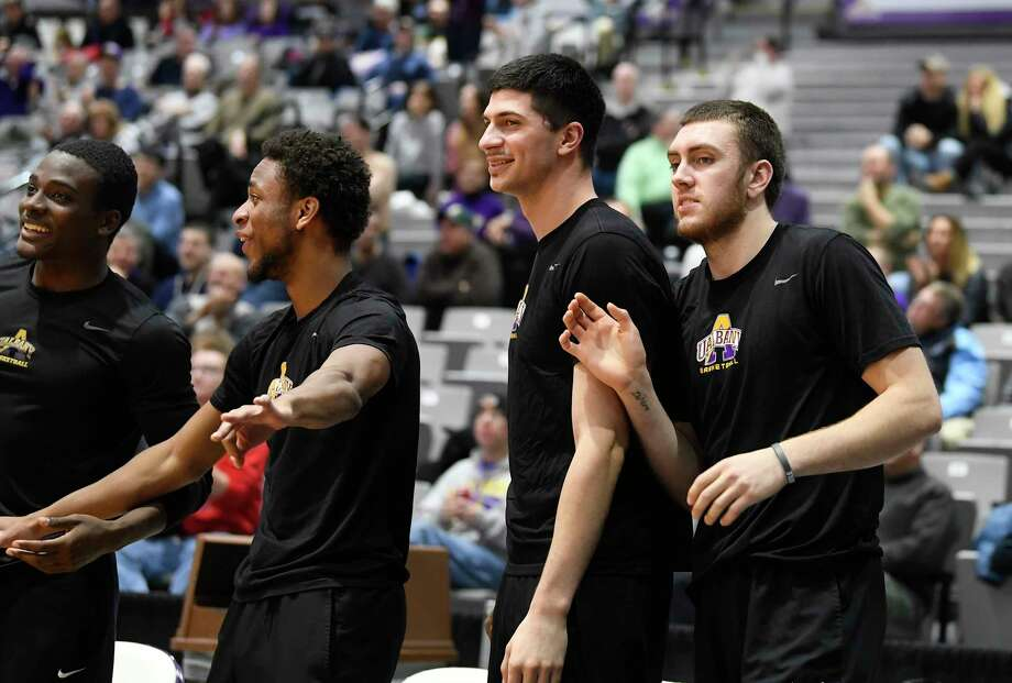 University at Albany guard Philip Flory right, cheers for teammates during the first half of an NCAA college basketball game against Manhattan Thursday, Dec 20, 2018, in Albany, N.Y. (Hans Pennink / Special to the Times Union) Photo: Hans Pennink / Hans Pennink