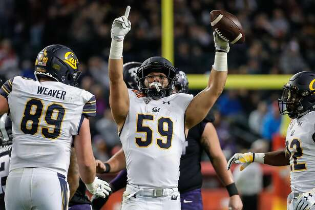 PHOENIX, AZ - DECEMBER 26: California Golden Bears linebacker Jordan Kunaszyk (59) celebrates an interception during the Cheez-It Bowl between the California Golden Bears and the TCU Horned Frogs on December 26, 2018 at Chase Field in Phoenix, Arizona. (Photo by Kevin Abele/Icon Sportswire via Getty Images)