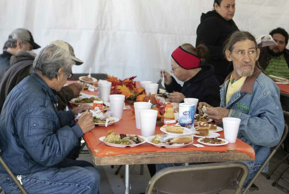 Diners sit to eat their Thanksgiving meals and desserts Nov. 22, 2018 at the Salvation Army Wayne Bergstrom Center of Hope in Conroe. The Salvation Army and Friends of Conroe passed out Thanksgiving meals to those who needed them. Photo: Cody Bahn, Houston Chronicle / Staff Photographer / © 2018 Houston Chronicle