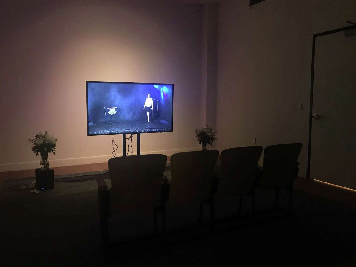 """Ryan Hawk's installation """"Sweet Surrender"""" at Lawndale Art Center included a room with a video cinema and another room with encased fabric sculpture. Hawk is among three Houston recipients of the Dallas Museum of Art's 2019 Awards for Artists."""