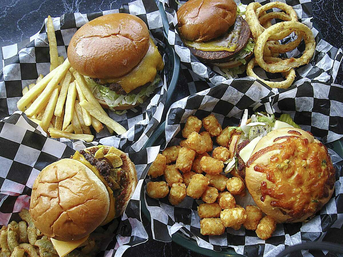 Burgers and sides from Cheesy Jane's burger shop. Clockwise from top left: Cheesy Jane burger with fries, Boca Burger veggie burger with onion rings, Southwest turkey burger with tater tots and a Bean Burger with Spicy Splinters.