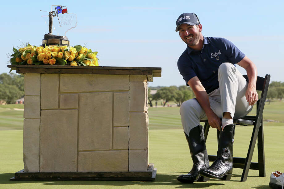 Andrew Landry tries on his new boots after winning the Texas Ope at TPC San Antonio on Sunday, April 22, 2018.  Landry shot a 4-under 68 on the final day, finishing 17-under to win the tournament, his first PGA Tour victory.  MARVIN PFEIFFER/mpfeiffer@express-news.net Photo: Marvin Pfeiffer, San Antonio Express-News / Express-News 2018
