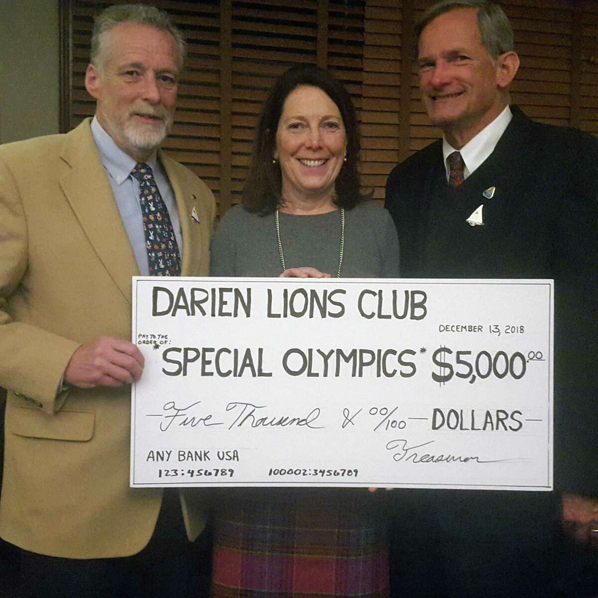 The LIONS Club of Darien held their annual holiday meeting on Dec. 13 at the Country Club of Darien. The LIONS presented the Darien Special Olympics team with a check for $5,000 in support of their sports competitions locally and statewide. From left, Peter Rogers, president of the LIONS Club of Darien; Kera Connolly, coordinator for Darien Special Olympics; and Allen O'Farrell, LIONS District 23A governor of Connecticut.
