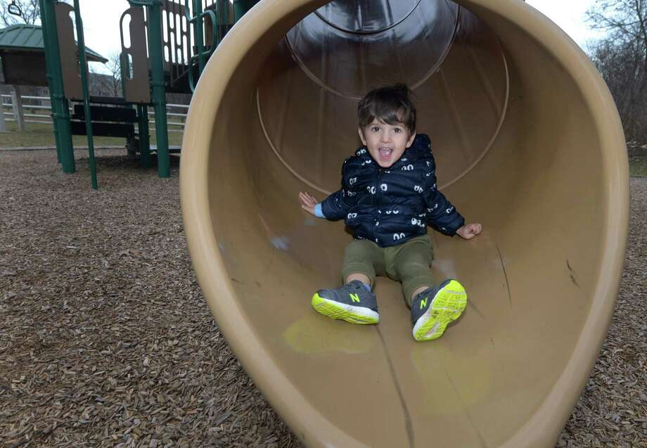 Jack Coppola, 3, of New Canaan plays on the playground at Cranbury Park Dec. 20 in Norwalk. Photo: Erik Trautmann / Hearst Connecticut Media / Norwalk Hour