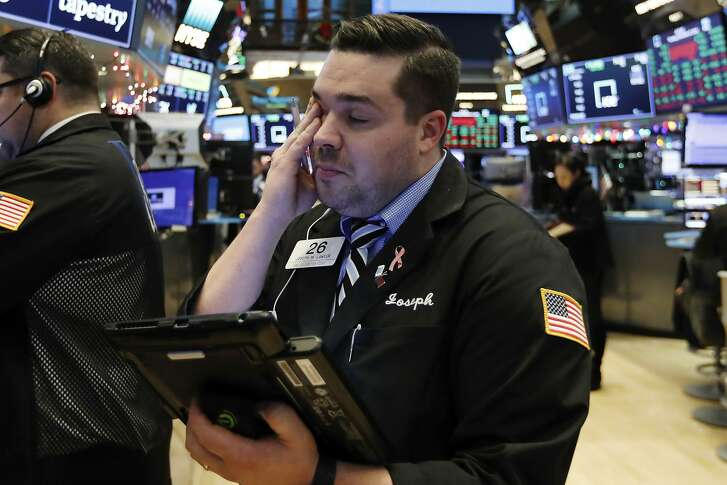 Trader Joseph Lawler works on the floor of the New York Stock Exchange at the closing bell, Thursday, Dec. 27, 2018. U.S. stocks staged a furious late-afternoon rally Thursday, closing with gains after erasing a 600-point drop in the Dow Jones Industrial Average. (AP Photo/Richard Drew)