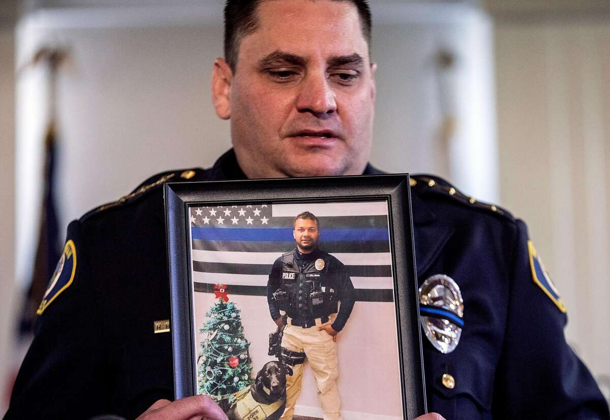 Newman Police Chief Randy Richardson holds a picture of Newman Police Officer Ronil Singh during a press conference held at the Newman Police Department in Newman, Calif. Thursday, Dec. 27, 2018 after Officer Singh was shot and killed during a traffic stop early Wednesday morning.