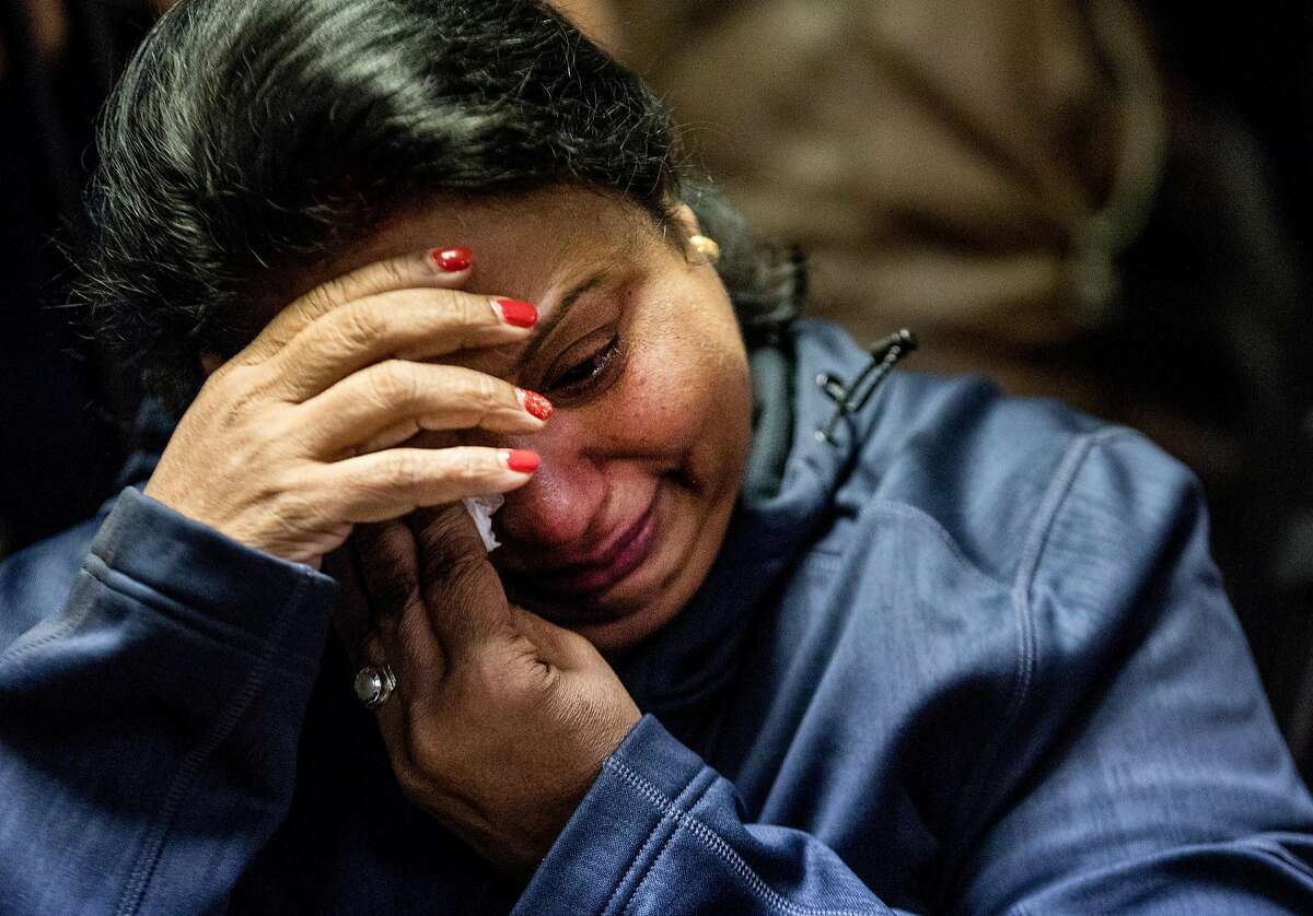 The aunt of Newman Police Officer Ronil Singh who wished not to be named becomes emotional during a press conference held at the Newman Police Department in Newman, Calif. Thursday, Dec. 27, 2018 after Officer Singh was shot and killed early Wednesday morning during a traffic stop.