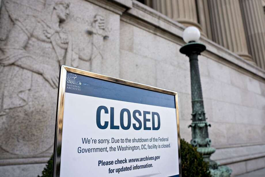 A sign announcing the closure of the National Archives due to a partial government shutdown is displayed in Washington, D.C., U.S., on Thursday, Dec. 27, 2018. The partial U.S. government shutdown will continue at least into this weekend, after House Republicans said they didn't plan to schedule any votes for Friday and President Donald Trump said most federal employees losing pay because of the closure were Democrats. Photographer: Andrew Harrer/Bloomberg Photo: Andrew Harrer, Bloomberg