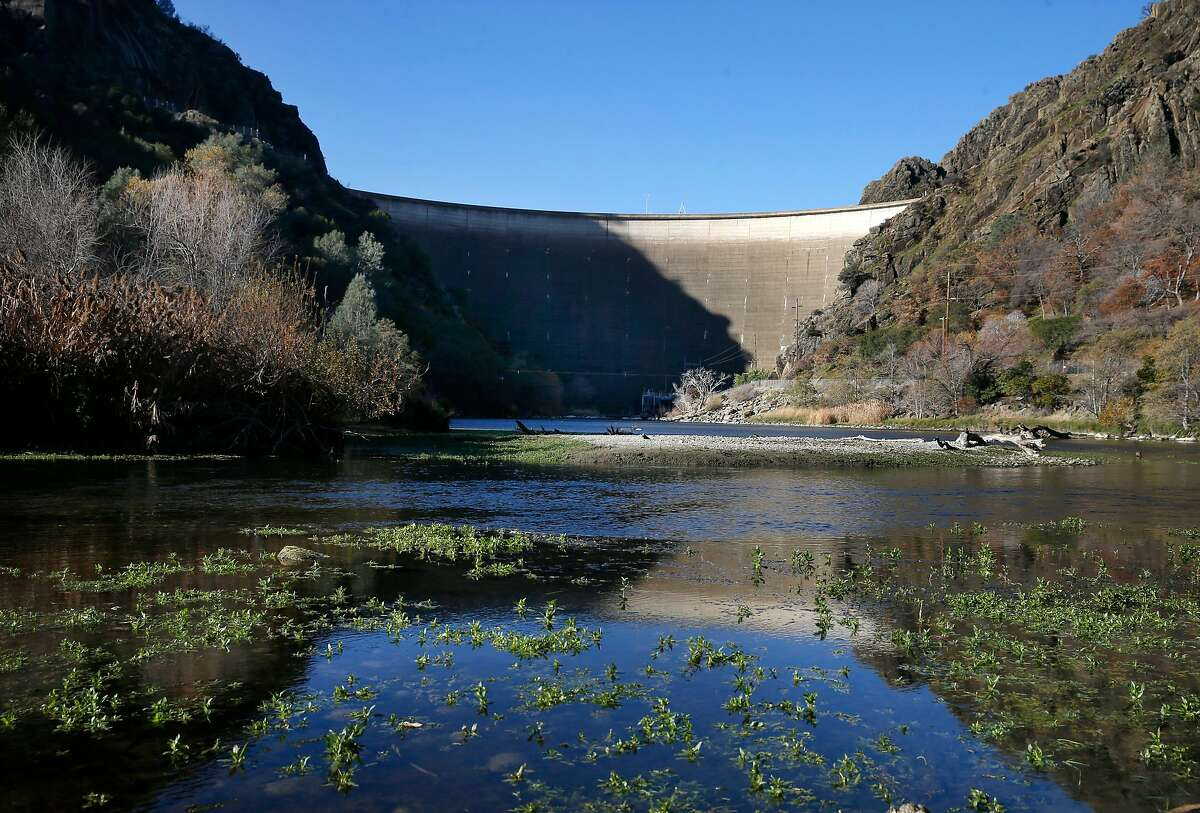 Putah Creek flows downstream from the base of Monticello Dam below Lake Berryessa near Winters, Calif. on Thursday, Dec. 27, 2018.