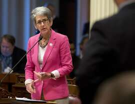 FILE - In this Thursday, June 30, 2016, file photo, State Sen. Hannah-Beth Jackson, D-Santa Barbara, responds to a question from Sen. Anthony Cannella R-Ceres, at the Capitol in Sacramento, Calif. California has become the first state to require publicly traded companies to include women on their boards of directors by 2020, according to a law signed Sunday by Gov. Jerry Brown. Having more women on boards will make companies more successful, says state Sen. Hannah-Beth Jackson, who authored the bill SB826. She believes having more women in power could also help reduce sexual assault and harassment in the workplace. (AP Photo/Rich Pedroncelli, File)