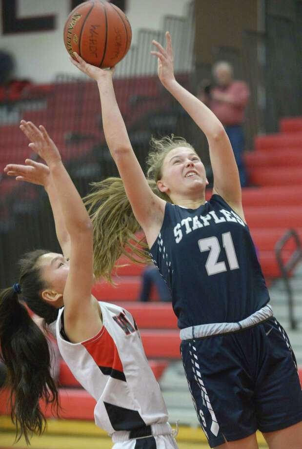 Staples' Marisa Shorrock, right, shoots past Fairfield Warde's Ava Fitzpatrick in the Thursday in Fairfield. Photo: Erik Trautmann / Hearst Connecticut Media / Connecticut Post