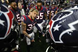 Houston Texans free safety Tyrann Mathieu (32) gathers his teammates together before an NFL football game against the Indianapolis Colts at NRG Stadium on Sunday, Dec. 9, 2018, in Houston.