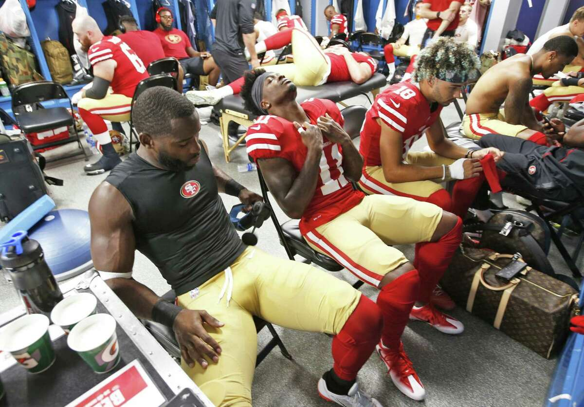 Pierre Garcon #15, Marquise Goodwin #11 and Dante Pettis #18 of the San Francisco 49ers relax in the locker room prior to the game against the Los Angeles Chargers at StubHub Center on September 30, 2018 in Carson, California. The Chargers defeated the 49ers 29-27.