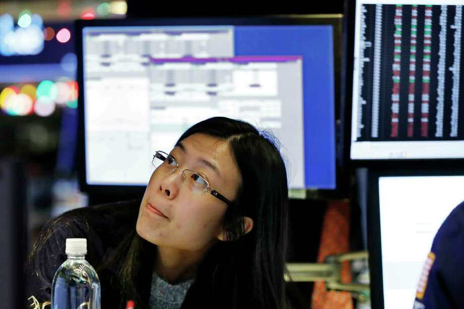 Specialist Vera Liu works on the floor of the New York Stock Exchange, Thursday, Dec. 27, 2018. Wall Street's wild Christmas week goes on, with the Dow Jones Industrial Average slumping 300 points at the open Thursday, a day after notching its biggest-ever point gain. (AP Photo/Richard Drew) Photo: Richard Drew / Copyright 2018 The Associated Press. All rights reserved