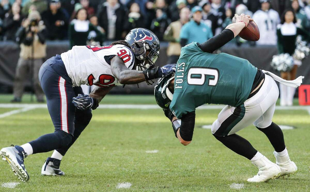 Houston Texans outside linebacker Jadeveon Clowney (90) sacks Philadelphia Eagles quarterback Nick Foles (9) to nullify a two-point conversion attempt during the first half of an NFL football game at Lincoln Financial Field on Sunday, Dec. 23, 2018, in Philadelphia.