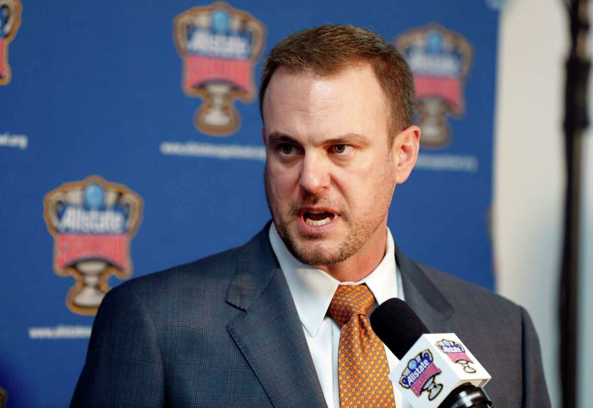 Texas head coach Tom Herman talks to media after the team arrived at Louis Armstrong New Orleans International Airport, for their upcoming game against Georgia in the NCAA football Sugar Bowl, in Kenner, La., Thursday, Dec. 27, 2018. (AP Photo/Gerald Herbert)