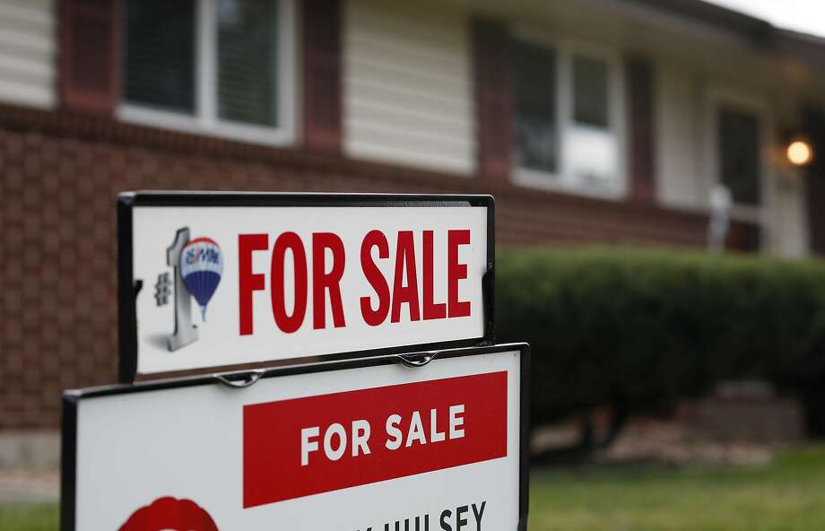 FILE - In this Oct 2, 2018, file photo a for sale sign stands outside a home on the market in the north Denver suburb of Thornton, Colo.  CONTINUE to see Houston's most beautiful homes of 2018.  Photo: David Zalubowski, Associated Press