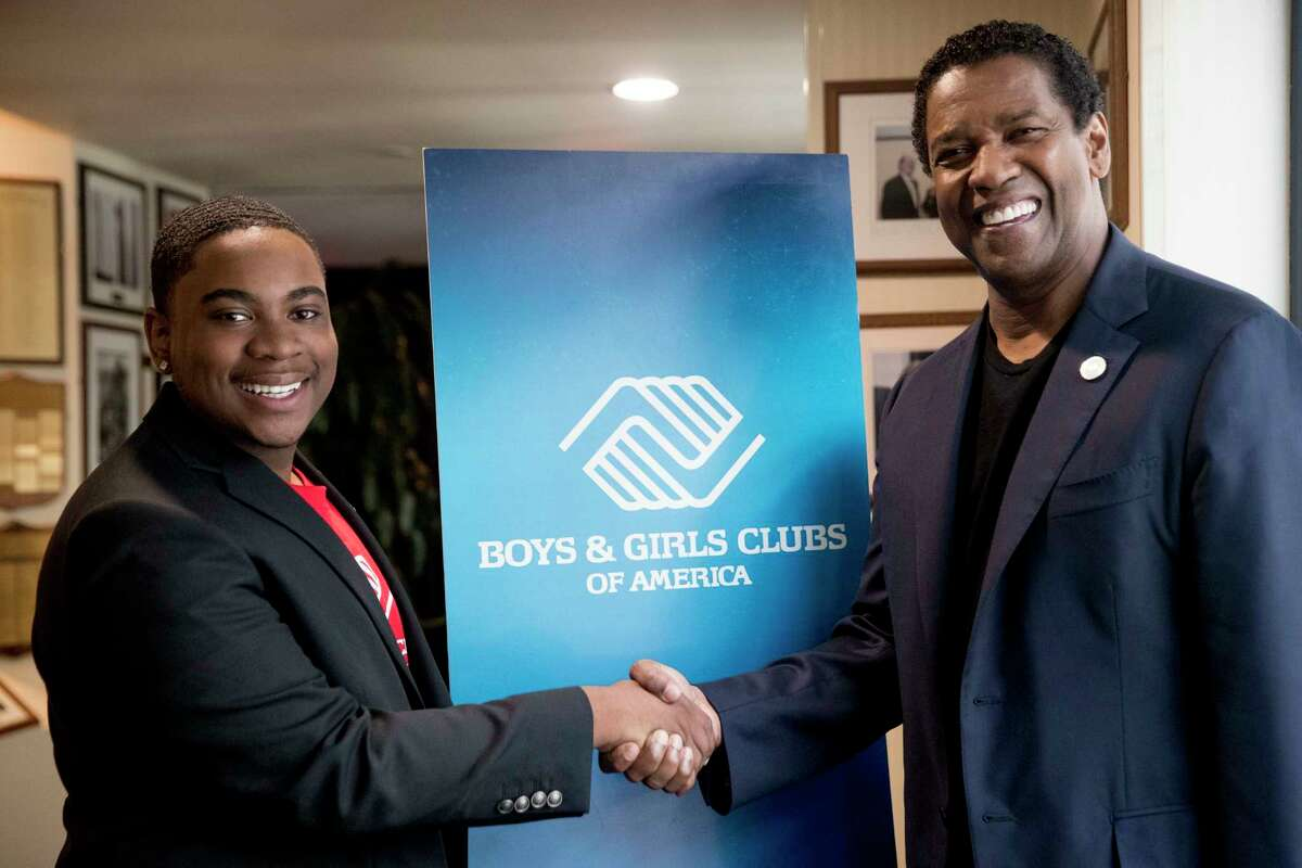 Malachi Haynes, left, and actor Denzel Washington, pose for a photograph following an interview with Fox News Anchor Chris Wallace at the National Press Club in Washington, Wednesday, Sept. 26, 2018. Boys & Girls Clubs of America has named Malachi Haynes the Southwest Youth of the Year. (AP Photo/Andrew Harnik)