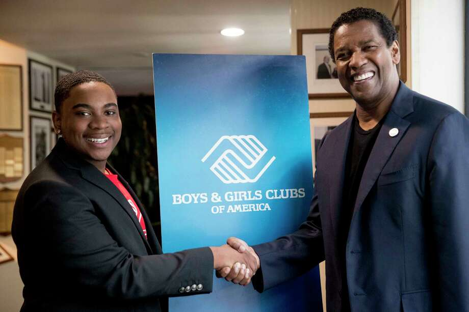 Malachi Haynes, left, and actor Denzel Washington, pose for a photograph following an interview with Fox News Anchor Chris Wallace at the National Press Club in Washington, Wednesday, Sept. 26, 2018. Boys & Girls Clubs of America has named Malachi Haynes the Southwest Youth of the Year. (AP Photo/Andrew Harnik) Photo: Andrew Harnik / Copyright 2018 The Associated Press. All rights reserved