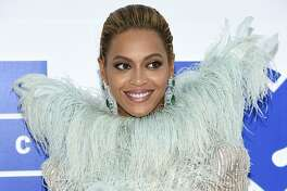 FILE - In this Aug. 28, 2016 file photo, Beyonce Knowles arrives at the MTV Video Music Awards at Madison Square Garden, in New York. There's no more juice in Beyonce's lemonade jar: The singer did not release new music though two albums featuring old Beyonce songs hit streaming services Thursday, Dec. 20, 2018. (Photo by Evan Agostini/Invision/AP, File)
