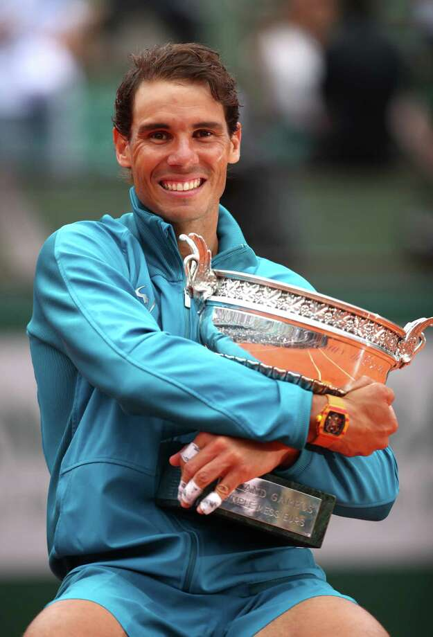 PARIS, FRANCE - JUNE 10:  Rafael Nadal of Spain holds the Musketeers' Cup as he celebrates victory following the mens singles final against Dominic Thiem of Austria during day fifteen of the 2018 French Open at Roland Garros on June 10, 2018 in Paris, France.  (Photo by Clive Brunskill/Getty Images) Photo: Clive Brunskill / 2018 Getty Images