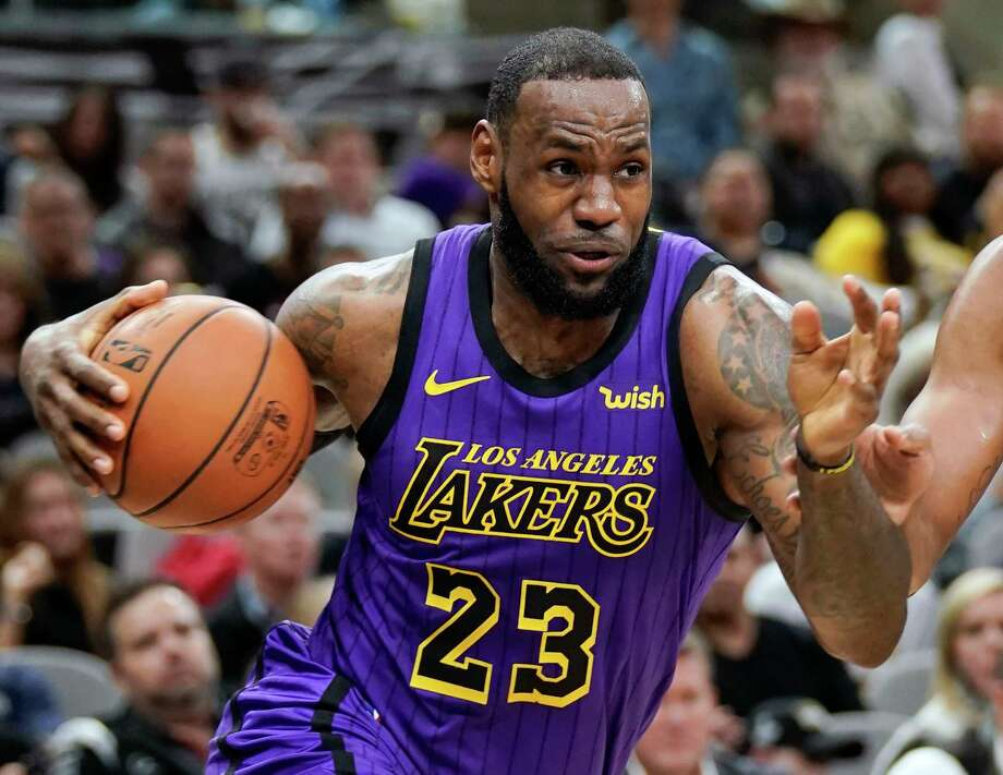 FILE - In this Dec. 7, 2018, file photo, Los Angeles Lakers' LeBron James (23) drives against the San Antonio Spurs during the first half of an NBA basketball game, in San Antonio. LeBron James was named The Associated Press Male Athlete of the Year on Thursday, Dec. 27, 2018. (AP Photo/Darren Abate, File) Photo: Darren Abate / Copyright 2018 The Associated Press. All rights reserved.