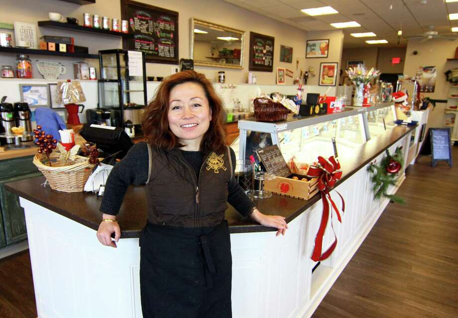 Liwen Ma, owner of Niko's Ice Cream and Confectionery Company, poses in the shop at the Go Green Plaza at 391 Boston Post Road in Orange, Conn., on Thursday Dec. 27, 2018. Photo: Christian Abraham / Hearst Connecticut Media / Connecticut Post