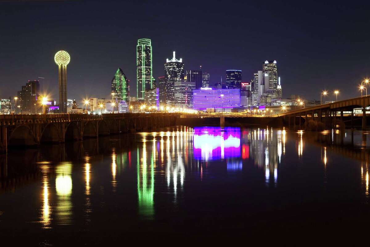 The Dallas Skyline is reflected in the swollen Trinity River, Thursday, Jan. 26, 2012, in Dallas. The Dallas Fort Worth area has received about four inches of rain over two days. (AP Photo/Brandon Wade)