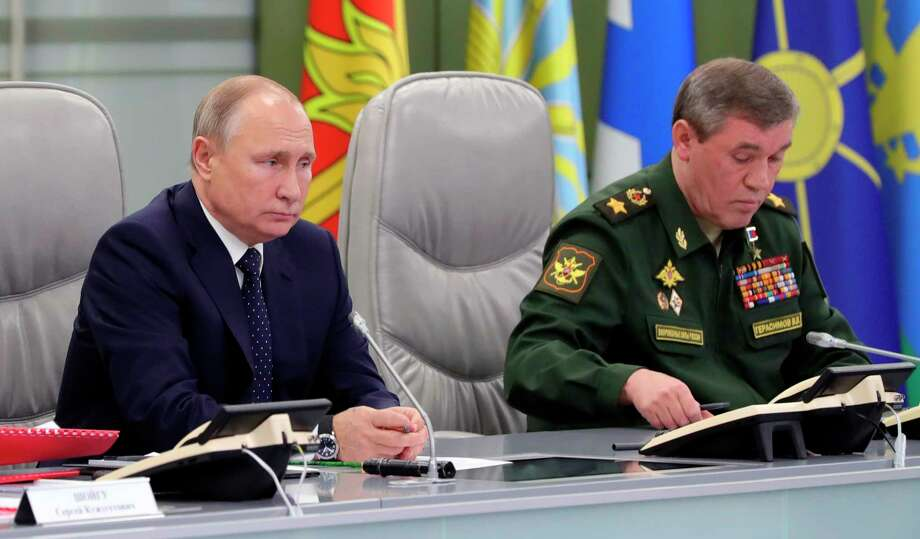 Russian President Vladimir Putin, left, and Chief of General Staff of Russia Valery Gerasimov oversee the test launch of the Avangard hypersonic glide vehicle from the Defense Ministry's control room in Moscow, Russia, Wednesday, Dec. 26, 2018. In the test, the Avangard was launched from the Dombarovskiy missile base in the southern Ural Mountains. The Kremlin says it successfully hit a designated practice target on the Kura shooting range on Kamchatka, 6,000 kilometers (3,700 miles) away. (Mikhail Klimentyev, Sputnik, Kremlin Pool Photo via AP) Photo: Mikhail Klimentyev / Copyright 2018 The Associated Press. All rights reserved