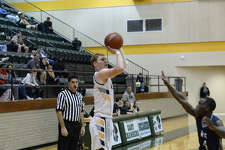 East Chambers Derek DeMoss pulls up for the shot from behind the three-point arc on Thursday at East Chambers High School.