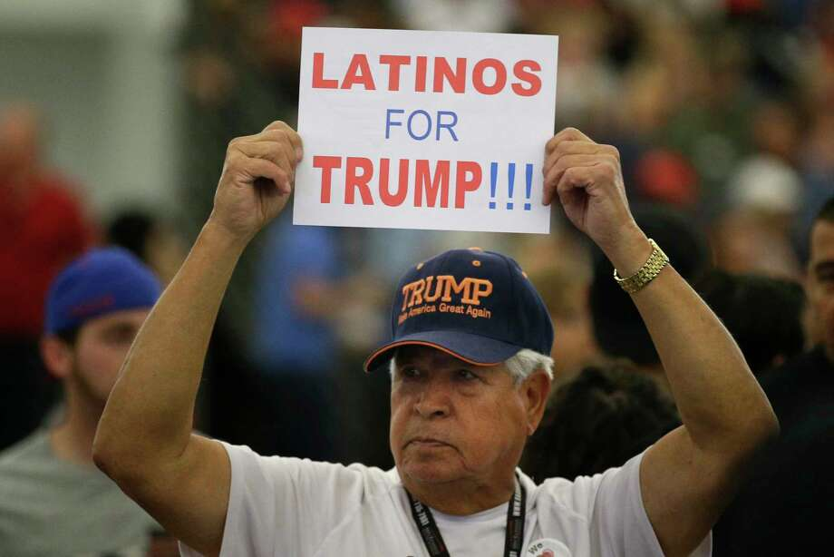 FILE - In this May 25, 2016, file photo, a man holds up a sign for then-Republican presidential candidate Donald Trump before the start of a rally at the Anaheim Convention Center, Wednesday, May 25, 2016, in Anaheim, Calif. Republicans are holding onto a steady share of the Latino vote in the Trump era. With a president who targets immigrants from Latin America, some analysts predicted a Latino backlash against the GOP. But it hasn't happened. Data from AP's VoteCast survey suggests Republicans are holding on to support from Latino evangelicals and veterans. (AP Photo/Jae C. Hong, File) Photo: Jae C. Hong / Copyright 2016 The Associated Press. All rights reserved. This m