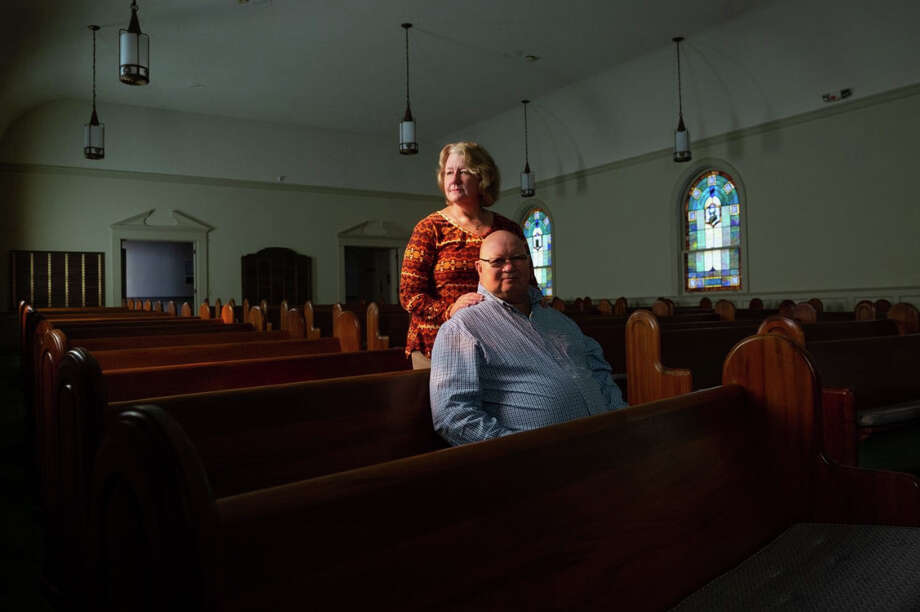 Lisa and Kenny Priddle are among 11 families who moved to Dothan, Ala., when a millionaire offered each up to $50,000 to attract more Jews to his hometown. Here, the Priddles pose for a portrait in the sanctuary at Temple Emanu-El. (Kevin D. Liles for the Washington Post) Photo: Kevin D. Liles