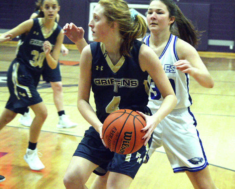 Father McGivney sophomore Anna McKee looks to pass the ball during Thursday's fifth-place game against Columbia at the Lebanon Christmas Tournament. Photo: Scott Marion/Intelligencer