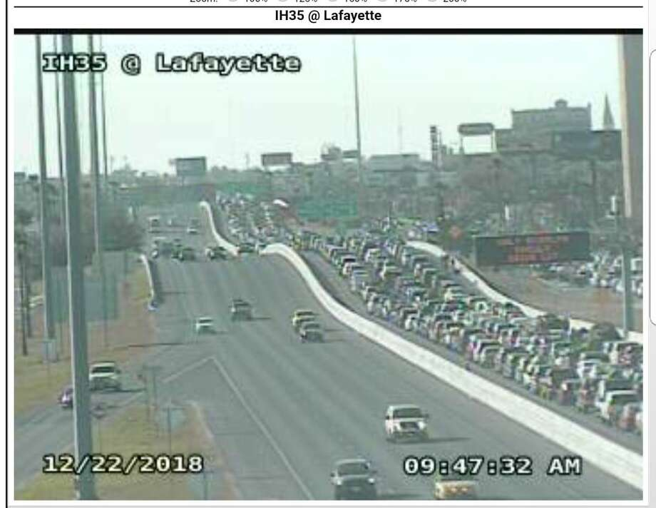 The Laredo Police Department posted this photo to their Facebook page Saturday morning, which shows southbound traffic on Interstate 35 backed up about two miles due to the large number of travelers crossing into Mexico for the holidays. Photo: Courtesy /Laredo Police Department