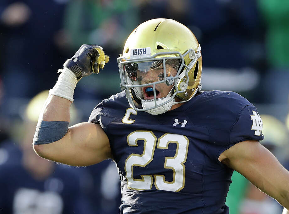File-This Oct. 13, 2018, file photo shows Notre Dame linebacker Drue Tranquill celebrating after making a tackle during the second half of an NCAA college football game against Pittsburgh. Notre Dame defensive captain Tranquill and leading receiver Miles Boykin weren't even Fighting Irish fans the last time they had a 12-0 regular season. Maybe that was a good thing since those current players didn't have to suffer through how that season ended. (AP Photo/Darron Cummings, File) Photo: Darron Cummings / Copyright 2018 The Associated Press. All rights reserved