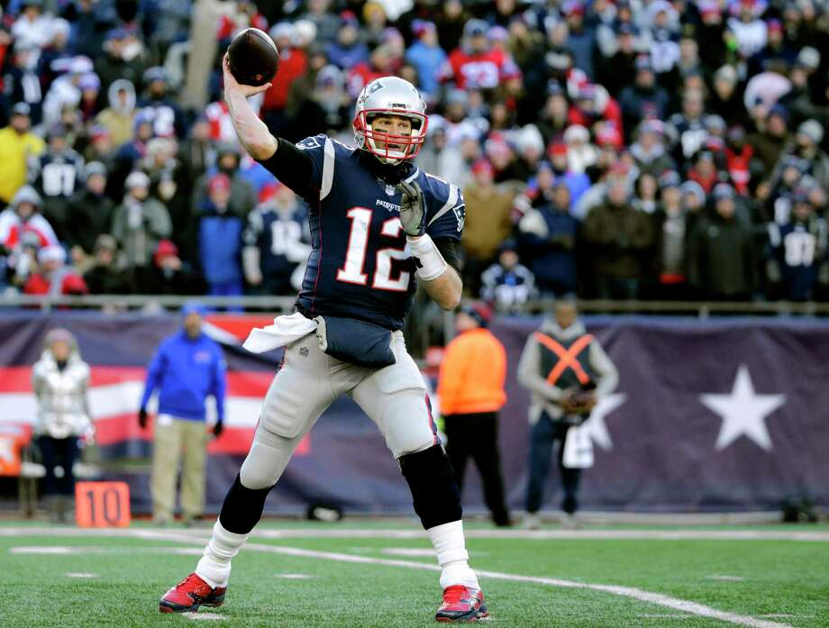 File-This Dec. 23, 2018, file photo shows New England Patriots quarterback Tom Brady passing against the Buffalo Bills during the second half of an NFL football game, in Foxborough, Mass.  Brady and the Patriots are the only team in the NFL without a loss at home (7-0). They could complete an undefeated home regular season for the seventh time since 2002 with a sixth straight victory over the Jets. (AP Photo/Elise Amendola, File) Photo: Elise Amendola / Copyright 2018 The Associated Press. All rights reserved