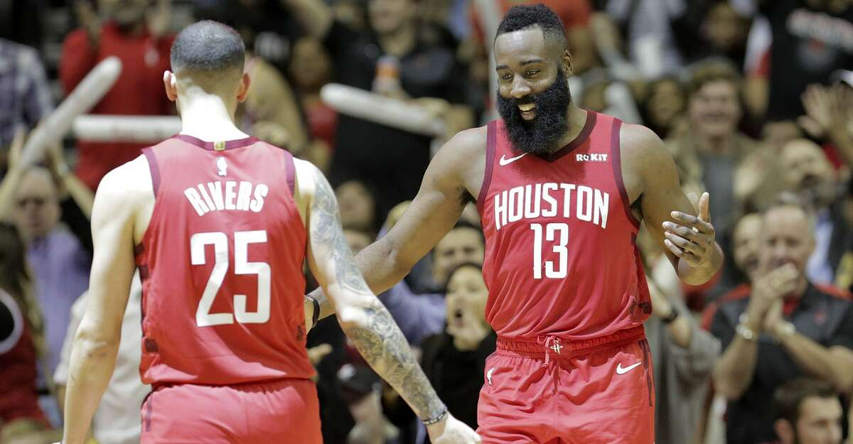 Houston Rockets guard James Harden (13) and guard Austin Rivers (25) celebrate the team's win over the Boston Celtics at the Toyota Center on Thursday, Dec. 27, 2018 in Houston. Rockets won the game 127-113.