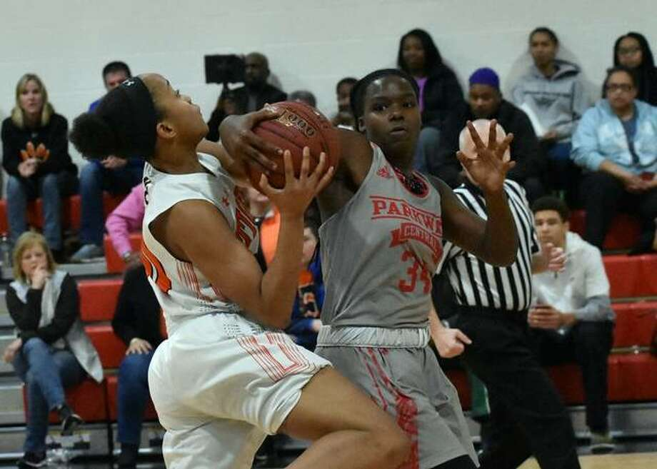 Edwardsville guard Jaylen Townsend has her shot blocked as she goes up for a layup in the first quarter. Photo: Matt Kamp/Intelligencer