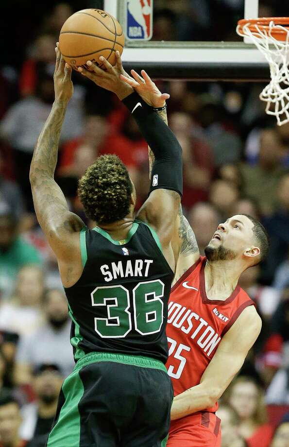f8562bfacff Boston Celtics guard Marcus Smart (36) shoots as Houston Rockets guard  Austin Rivers defends