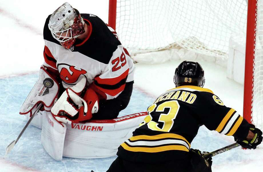 New Jersey Devils goaltender Mackenzie Blackwood (29) makes a save on a shot by Boston Bruins left wing Brad Marchand (63) during the third period of an NHL hockey game Thursday, Dec. 27, 2018, in Boston. The Devils won 5-2. (AP Photo/Elise Amendola) Photo: Elise Amendola / Copyright 2018 The Associated Press. All rights reserved