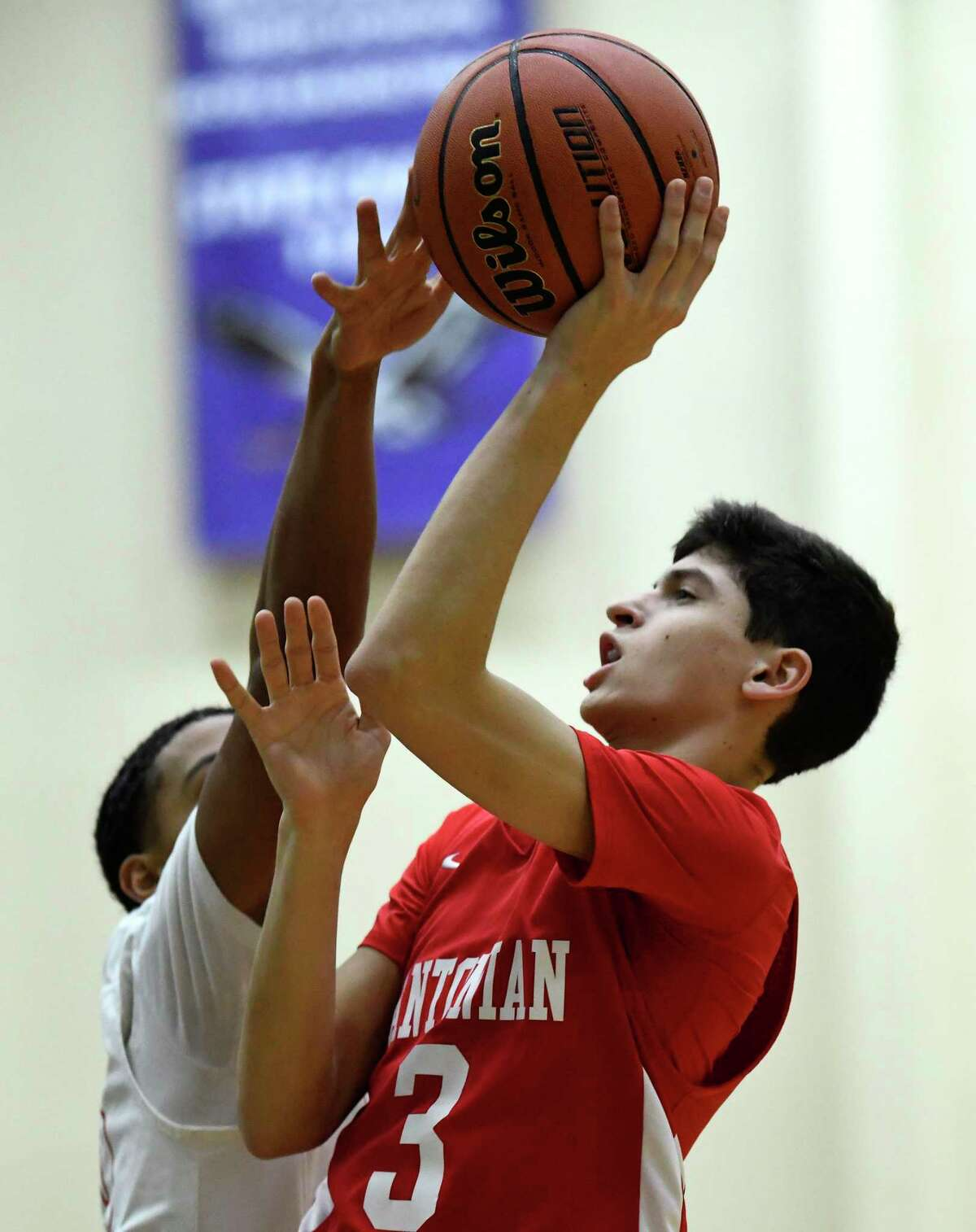 Gavino Ramos of Antonian shoots during the San Antonio Independent School District boys basketball tournament at the Alamo Convocation Center on Friday, Dec. 7, 2018.