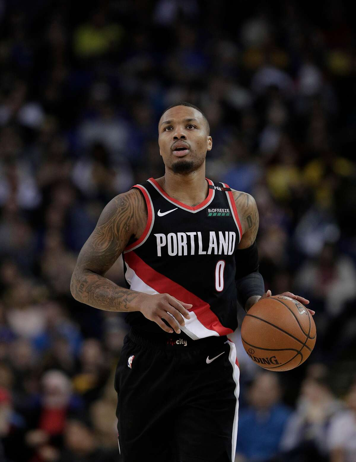 Damian Lillard (0) dribbles up the court in the first half as the Golden State Warriors played the Portland Trailblazers at Oracle Arena in Oakland, Calif., on Thursday, December 27, 2018.
