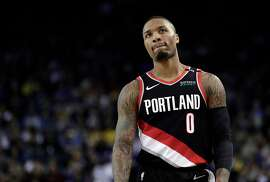 Damian Lillard (0) walks up court in the first half as the Golden State Warriors played the Portland Trailblazers at Oracle Arena in Oakland, Calif., on Thursday, December 27, 2018.