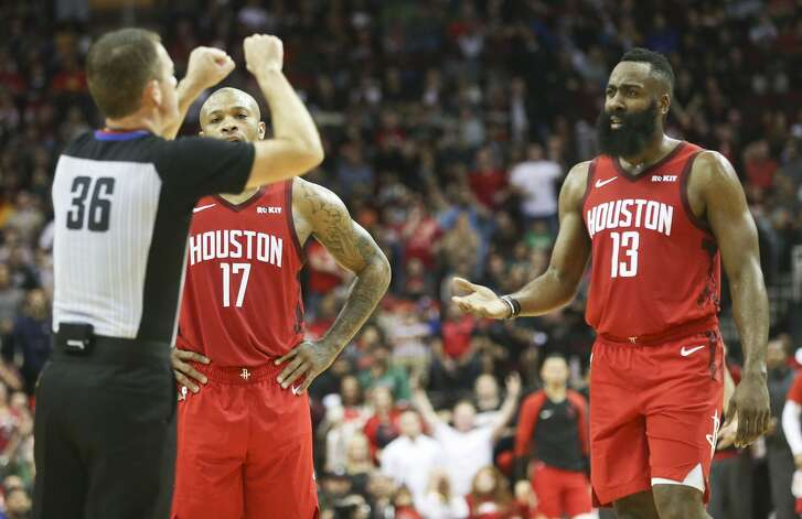 Houston Rockets guard James Harden (13) contests a technical call with referee Brent Barnaky after Houston Rockets center Clint Capela (15) was called for holding onto the rim after a dunk.
