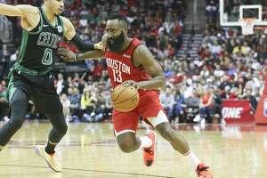 Houston Rockets guard James Harden (13) drives to the hoop past Boston Celtics forward Jayson Tatum (0) at the Toyota Center on Thursday, Dec. 27, 2018 in Houston. Rockets won the game 127-113.
