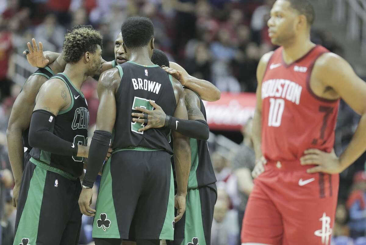 Boston Celtics huddle before Houston Rockets guard Eric Gordon (10) shots two free throws at the Toyota Center on Thursday, Dec. 27, 2018 in Houston. Rockets won the game 127-113.